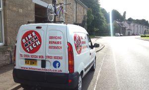 Van outside repair shop
